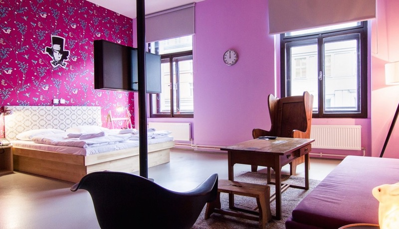 A Bold, Colorful Hotel Room in a hotel inspired by Alice In Wonderland