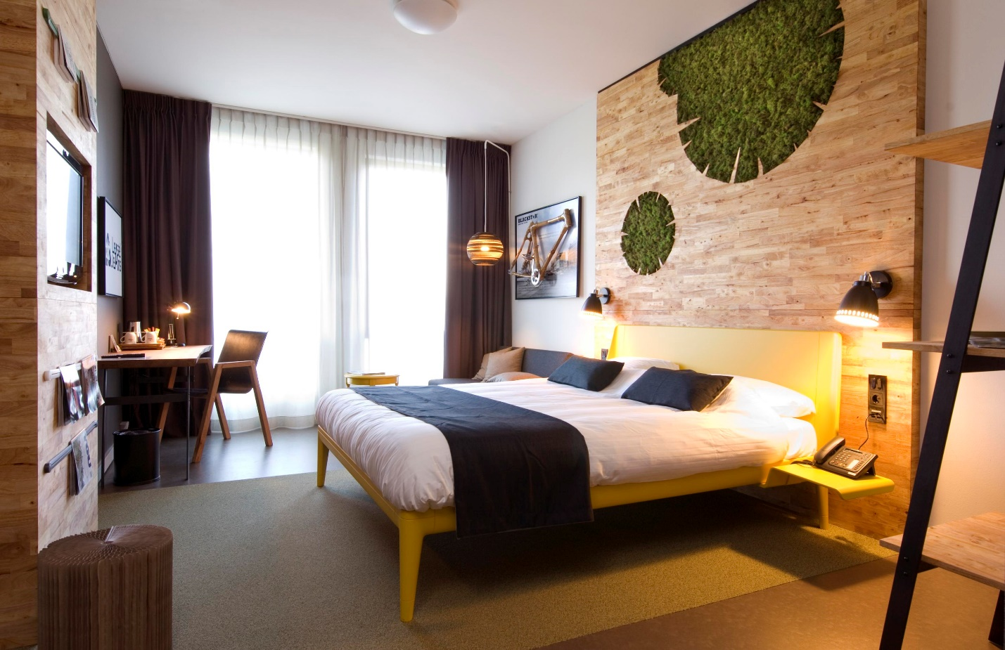 Green Hotel Room with Natural Light, a green wall and sustainable materials